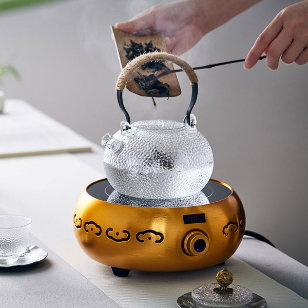 glass teapot with metal handle